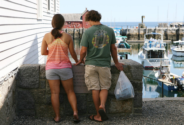 David Le/Gloucester Daily Times. Elizabeth Gardell, left, and Peter Novello, or North Andover, stop for a moment and gaze out at Rockport Harbor.