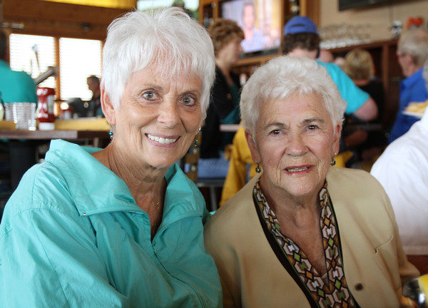Linda Castagna, of Milford, NJ, left, sits with Dorothy Buckley, at teh Seaport Grille at Cruiseport Gloucester on Thursday afternoon. Last spring Dorothy was hit by a car while crossing the street and Linda, who happened to be in town for vacation, came to her aid. Since the accident, Linda has been keeping in touch with Dorothy's daughter Jane Cahill, but the two families had never met until they came together for lunch at the Seaport Grille on Thursday. David Le/Gloucester Daily Times