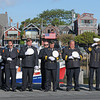 Rockport: Rockport Firefighters bow their heads in a moment of silence, remembering those who lost their lives 10 years ago on 9/11 in New York. Police, Fire and locals took part in a ceremony held on T-Wharf Sunday morning. Desi Smith/Gloucester Daily Times. September 11, 2011
