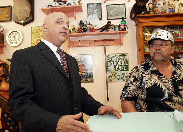 Mayoral candidate Ken Sarofeen, left, talks with David Tucker, owner of Tucker's Farm Family Diner and answers questions from other patrons on Thursday afternoon in the diner. David Le/Gloucester Daily Times