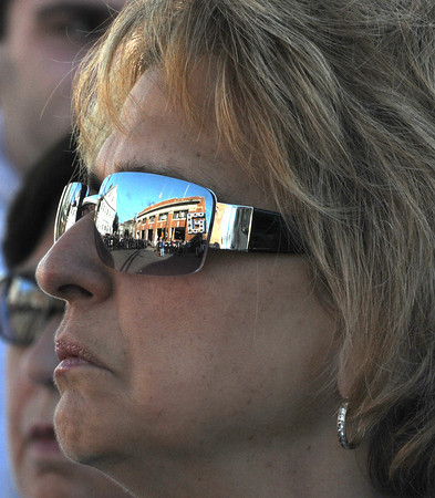 Gloucester: A woman in the crowed watches the 911 ceremony held at Central Fire Station Sunday morning.   Desi Smith/Gloucester Daily Times. September 11, 2011