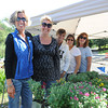 Gloucester: Parents from left to right Kim Ventimiglia, Lisa Howlett, Keri Russo, Linda Pata and Pam Taormina stand behind an arrangement of plants and flowers that had up for sale at the West Parish Elementary School to raise money, Sunday afternoon. Desi Smith/Gloucester Daily Times. September 18, 2011