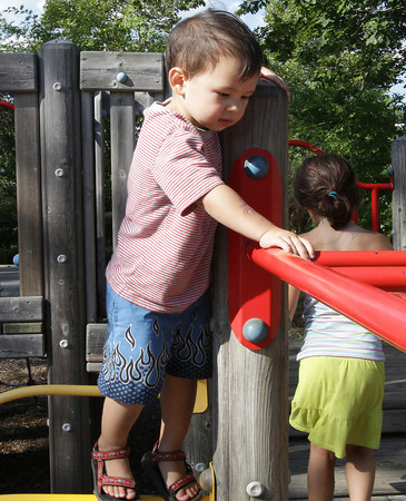 David Le/Gloucester Daily Times. Everett Pang, 2, of Duxbury, contemplates his next move on the monkey bars at Masconomo Park in Manchester while visiting his grandparents.