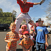 Gloucester: Boston Red Sox, Big League Brain and Blinkee the Clown, were on hand at the Grand Opening of Sullivan Tire  at 44 Bass Ave Saturday morning to greet guest like, Ashley Wilson and her three boys from left, Justyce 4, Jamyson 7, and Jayson 6, from Gloucester.  Desi Smith/Gloucester Daily Times. September 10, 2011