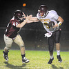 Gloucester:  Gloucester's Michael Falzarano gets stiff armed by Weymouth's QB Cam McLevedge as he trys to take him down,last night at Newell Stadium. Desi Smith/Gloucester Daily Times. September 23, 2011