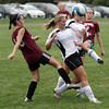 Rockport High School Alumni Emily Douglass, left, and Janelle Dineen, right, get tangled up with current Rockport High School players, Amanda Chalmers, second from left, and Isobel MacCrate, second from right, during the Alumni Soccer game on Monday afternoon. David Le/Gloucester Daily Times.