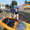 Cynthia Franklin, of Manchester, pulls her kayak into the water behind the Manchester police station for an afternoon adventure. David Le/Gloucester Daily Times.