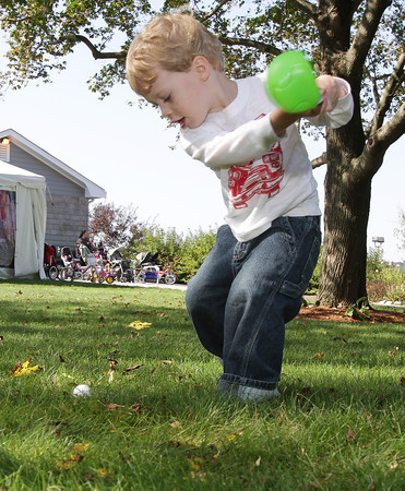 Ethan Lanier, 2, plays golf behind Woodman's in Essex on Friday morning. David Le/Gloucester Daily Times
