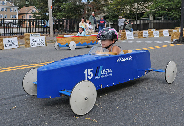 Gloucester: Alexis Wiswall (right) takes first place against Katelyn Hinckley in the Modified Divison, at the Fishbox Durby held Sunday afternoon on Roger St.   Desi Smith/Gloucester Daily Times. September 18, 2011