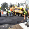 Construction workers smooth out new pavement near The Village Restaurant on the corner of Routes 22 and 133 on Main St. in Essex on Friday afternoon. David Le/Gloucester Daily Times.