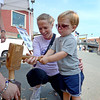 Gloucester: Jen Schaefer helps her son Kyle 2, make a trunnel used in schooner building,Saturday afternoon at Harbor Loop Heritage Day.  Desi Smith /Gloucester Daily Times. September 3,2011