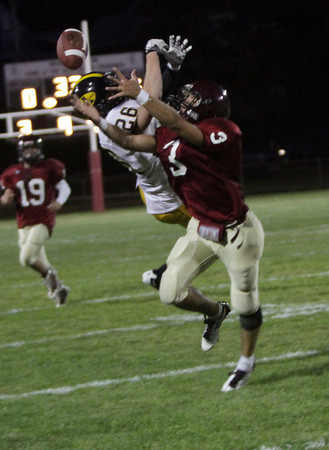 Gloucester quarterback Leonardo Taormina's pass is just out of the reach of the outstretched arms of Santo Parisi with Andover's Jack Slyvester in coverage. David Le/Gloucester Daily Times