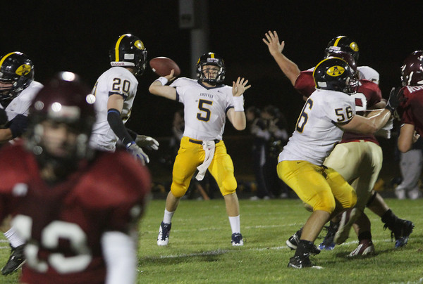 Andover quarterback CJ Scarps looks to pass against Gloucester's defense. David Le/Eagle-Tribune