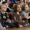 From left, Jeramy Adamson, Grace Englis, and Evelyn York pay close attention to a presenter during an assembly at Rockport Elementary School. David Le/Gloucester Daily Times