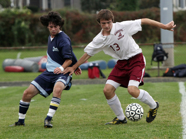 Gloucester's Cal Cosgrove, right, shields the ball from Peabody's Chris Sinvil, during their game on Wednesday. David Le/Gloucester Daily Times