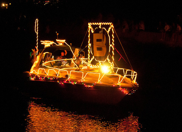 Gloucester: A boat pass through the Blyman Canal showing their Bruins Pride. Saturaday night. Desi Smith /Gloucester Daily Times. September 3,2011