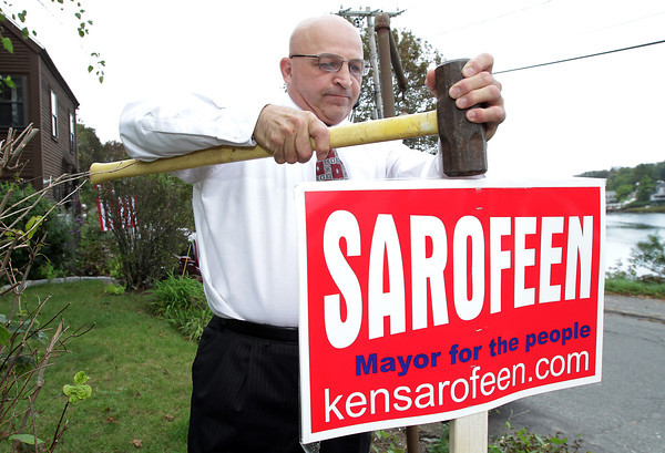 Mayoral candidate Ken Sarofeen, puts up a sign on the lawn of a supporter on Thursday afternoon. Campaigns have been slowly getting underway and Sarofeen will be running against incumbent Mayor Carolyn Kirk. David Le/Gloucester Daily Times