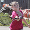 Annabelle Haskell, 12, of Essex, keeps her eye on the ball as she plays tennis on the courts near the TOPH Burnham Library on Friday afternoon. David Le/Gloucester Daily Times