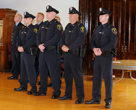 Gloucester: New police and Fire recrutes stand and are about to be sworn in by Mayor Kirk, last night at City Hall. Desi Smith/Gloucester Daily Times. September 22, 2011