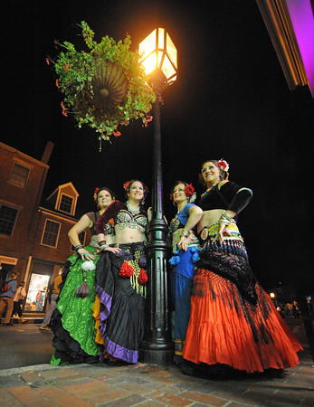 Gloucester:  Belly Dancer performer's from left, Kristen McCarthy, Eva Jackson,Cecile Carr and Debra Lee finished their last show, on the last night of Block Parties held on Main St Saturday evening. The group that performs American Style Dance are from Carlisle,Mass  Desi Smith/Gloucester Daily Times. September 17, 2011