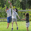 Essex:  Luke Quine 10, (left) and Ben Soulard 10, go up for a pass thrown by Sophie Quine 7, on Western Ave Wednesday afternoon. The trio took advantage of a half day off from school and some good weather. Rain is expected tomorrow. Desi Smith/Gloucester Daily Times. September 21, 2011