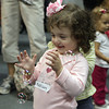 Maddison Goodhue, 2, of Gloucester, smiles as she pops bubbles at a storytime hour at Sawyer Free Library on Wednesday morning. David Le/Gloucester Daily Times
