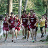 The Gloucester boy's cross country team run up a hill in a pack as they compete against Lynn Classical on Wednesday afternoon. David Le/Gloucester Daily Times