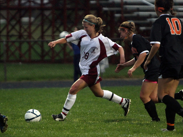 Gloucester High School midfielder Melodie Orrell runs by a Beverly defender and winds up for a shot on net. David Le/Gloucester Daily Times