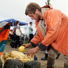 Noah Kellerman, of Aprilla Farm in Essex, arranges some squash for display at the Cape Ann Farmer's Market at Stage Fort Park in Gloucester. David Le/Gloucester Daily Times