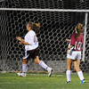 Gloucester:  Gloucester's Meaghan Quinn nets the first goal for Gloucester, as a dejected Marnie Biondi of Lynn English reacts,last night at Newell Stadium. Desi Smith/Gloucester Daily Times. September 28, 2011