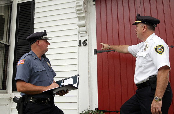 Essex Police Chief Peter Silva, right, and Detective Mike French paid a visit to Winthrop St. on Thursday afternoon to assess properly numbered homes as well as improperly numbered ones as well. During the next few weeks the Essex Police Department will be going around and enforcing a state law, and town bylaw, that states houses must have numbers clearly marked on the front of each house. Chief Silva says having clearly numbered houses will help reduce response times for emergencies and that police will be warning people first, and if they fail to comply, then will be handed a fine. David Le/Gloucester Daily Times