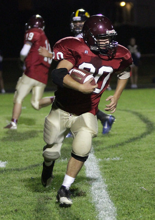 Gloucester junior runningback Mark Horgan rushes for positive yards against Andover on Friday evening. Horgan took a screen pass from quarterback Leonardo Taormina to the endzone for Gloucester's first touchdown of 2011. David Le/Gloucester Daily Times