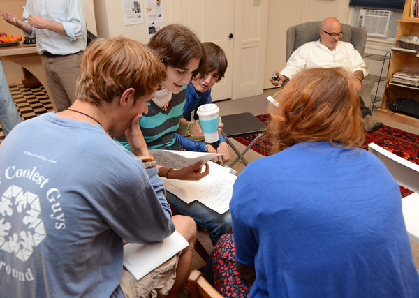 Gloucester: GHS students right to left Zoe Paddock 16, Wes Dunn 17, Maryka Gillis 17, and Lucus Olson 17, look over some writtings before a Release Party and Reading of THE Elicitordone a Literary and Artistic Magazine done by them and others at the Gloucester Writers Center Wednesday night. . Desi Smith/Gloucester Daily Times. September 7, 2011