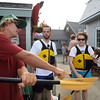 Tim Mears, left, a kayaking instructor at North Shore Kayak Outdoor Center, gives some pointers to Holly Stein, 17, of Rockport, and her brother Scott, center, before they go out kayaking on Monday afternoon. David Le/Gloucester Daily Times.