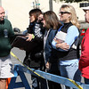 Phil Dench, left, talks with Krista Julian, owner of Savour Kathleen Erickson, Tonya Woolcott, and Patsy Knispel as they stand right out side the wine and cheese shop which was badly damaged in the fire on Thursday night.  David Le/Gloucester Daily Times