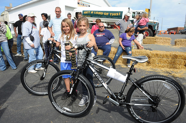 Gloucester: Ava Wiswall 9,(left) who placed first in the Freestyle Divison and her sister Alexis 9, placed first in the Moified Divison, at the Fishbox Derby,Sunday afternoon on Roder St. The pair took home the top prize, a trophy and new bike from Seaside Cycle in Manchester by the Sea.  Desi Smith/Gloucester Daily Times. September 18, 2011