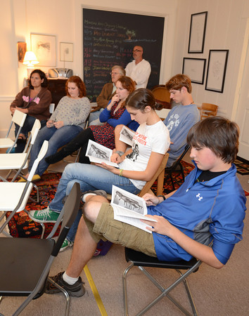 Gloucester: GHS students listen to  James Cook read some of the works from THE Elicitordone a Literary and Artistic Magazine done by them and others at the Gloucester Writers Center Wednesday night. . Desi Smith/Gloucester Daily Times. September 7, 2011