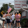 Customers visiting Woodman's on Main St. in Essex, line up along the sidewalk outside just to order their food. David Le/Gloucester Daily Times.