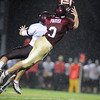 Gloucester:  Gloucester's Santo Parisi lays himself out for a pass that just goes off his finger tips against Weymouth,last night at Newell Stadium. Desi Smith/Gloucester Daily Times. September 23, 2011