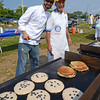Gloucester: Master Chef contestant Christian Collins cooks blueberry pancakes next to rotarian Steve Kaity at the Rotary Pancake Breakfast at Stage Fort Park Saturday morning.Desi Smith /Gloucester Daily Times. August 20,2011
