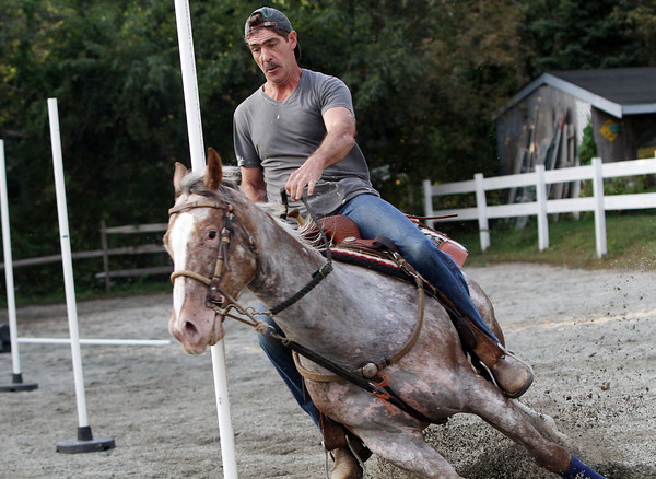 "Richard Burnham, of Rockport, rides ""Slip Me Another Kiss,"" an appaloosa horse, around poles at Sandy Bay Stables on Tuesday afternoon. David Le/Gloucester Daily Times"