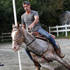 """Richard Burnham, of Rockport, rides """"Slip Me Another Kiss,"""" an appaloosa horse, around poles at Sandy Bay Stables on Tuesday afternoon. David Le/Gloucester Daily Times"""
