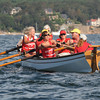 Gloucester: Gloucester Gig Rowers row their Gig, the Siren Song in the Gloucester Maritime Heritage Gig Rowers Race that started at Niles Beach Saturday morning.  Desi Smith/Gloucester Daily Times. September 10, 2011