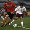 Gloucester High School's Alex Davis, right, shields the ball from Beverly's Cam Rogers during their game on Thursday evening. David Le/Gloucester Daily Times