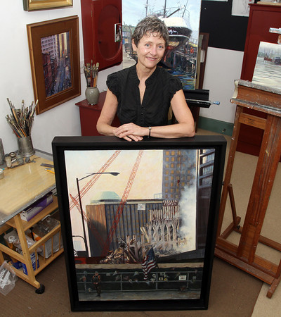 "Local artist BJ Wayne stands with her painting ""Missing"" of Ground Zero in New York City in the aftermath of the September 11th attacks. David Le/Gloucester Daily Times."