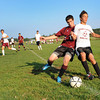 Gloucester:  Gloucester's Alex Dahlmer battles a Rockport player for control of the ball, Monday afternoon at the Magnoila Feild. Desi Smith/Gloucester Daily Times. September 12, 2011