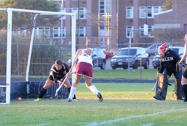 Gloucester:  Gloucester's Marlee Melvin puts the ball by a Salem defender as Salem's Goalkeep only can watch, at GHS yesterday afternoon. Desi Smith/Gloucester Daily Times. September 19, 2011