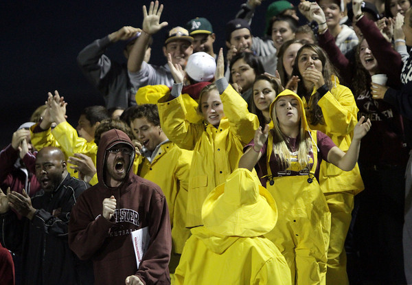 Gloucester Fishermen fans have something to cheer about after Mark Horgan took a screen pass for a long TD. David Le/Gloucester Daily Times