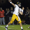 Andover quarterback CJ Scarps drops back to pass against Gloucester on Friday night at Newell Stadium. David Le/Eagle-Tribune
