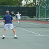 Gloucester: Ed Frick returns a volley with partner Chris Delisi in a Doubles match against Chris Murphy and Andy Rappoli Saturday morning at Bass Rocks Open Tennis Tourney.  Desi Smith /Gloucester Daily Times. September 3,2011